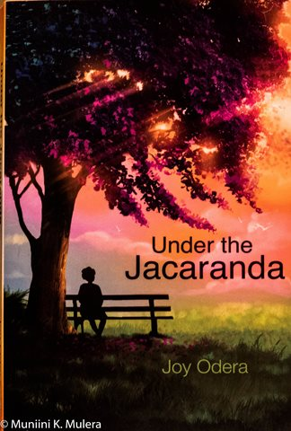 Under the Jacaranda  - by Joy Odera